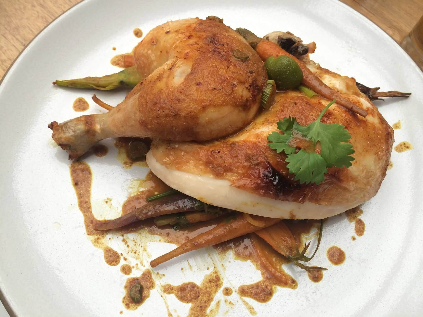 Entree--Spit Roasted Chicken. preserved lemon, olives, wild fennel, curry, carrot