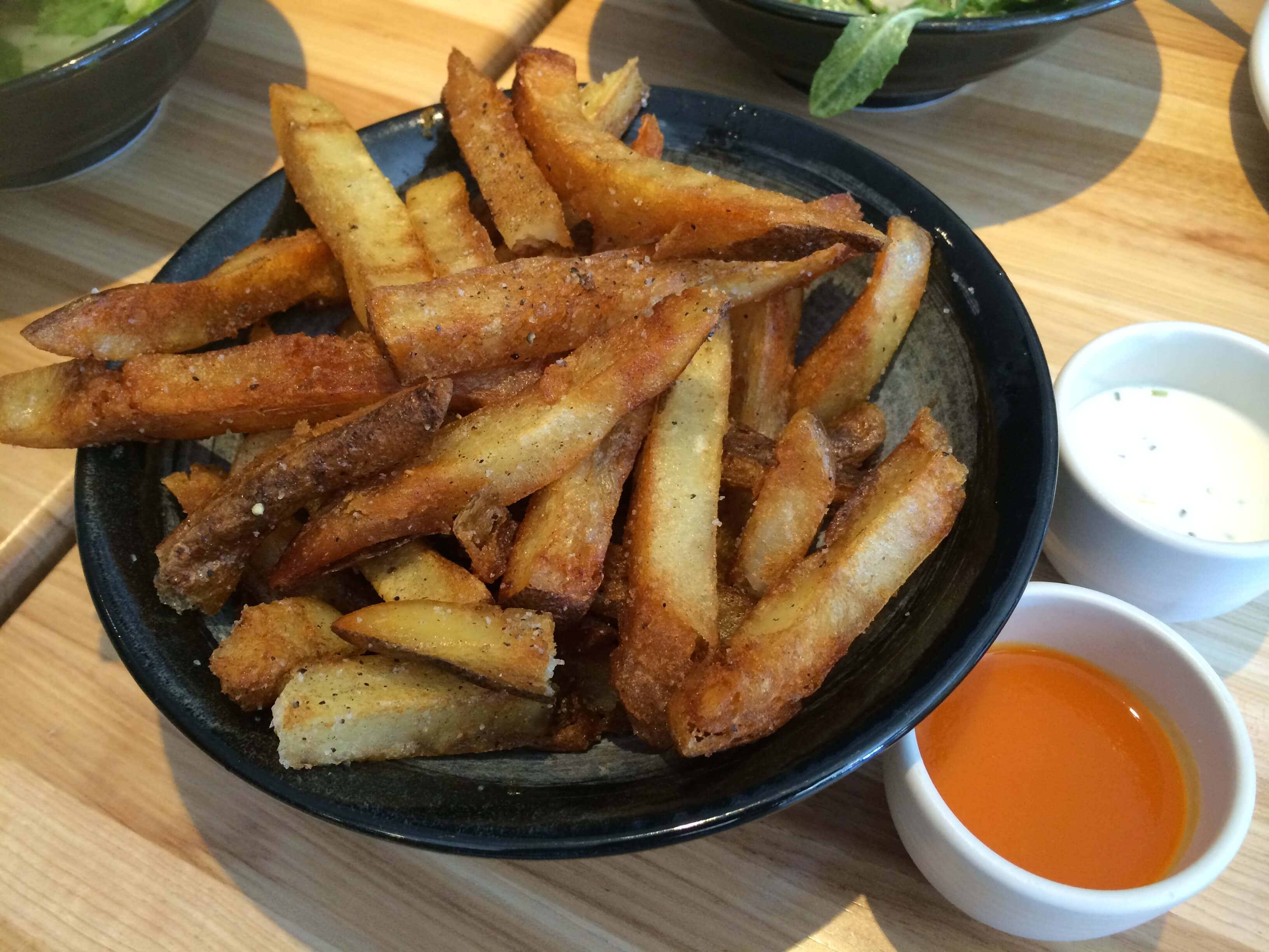 French Fries, served with House Hot Sauce and Chive Creme Fraiche.