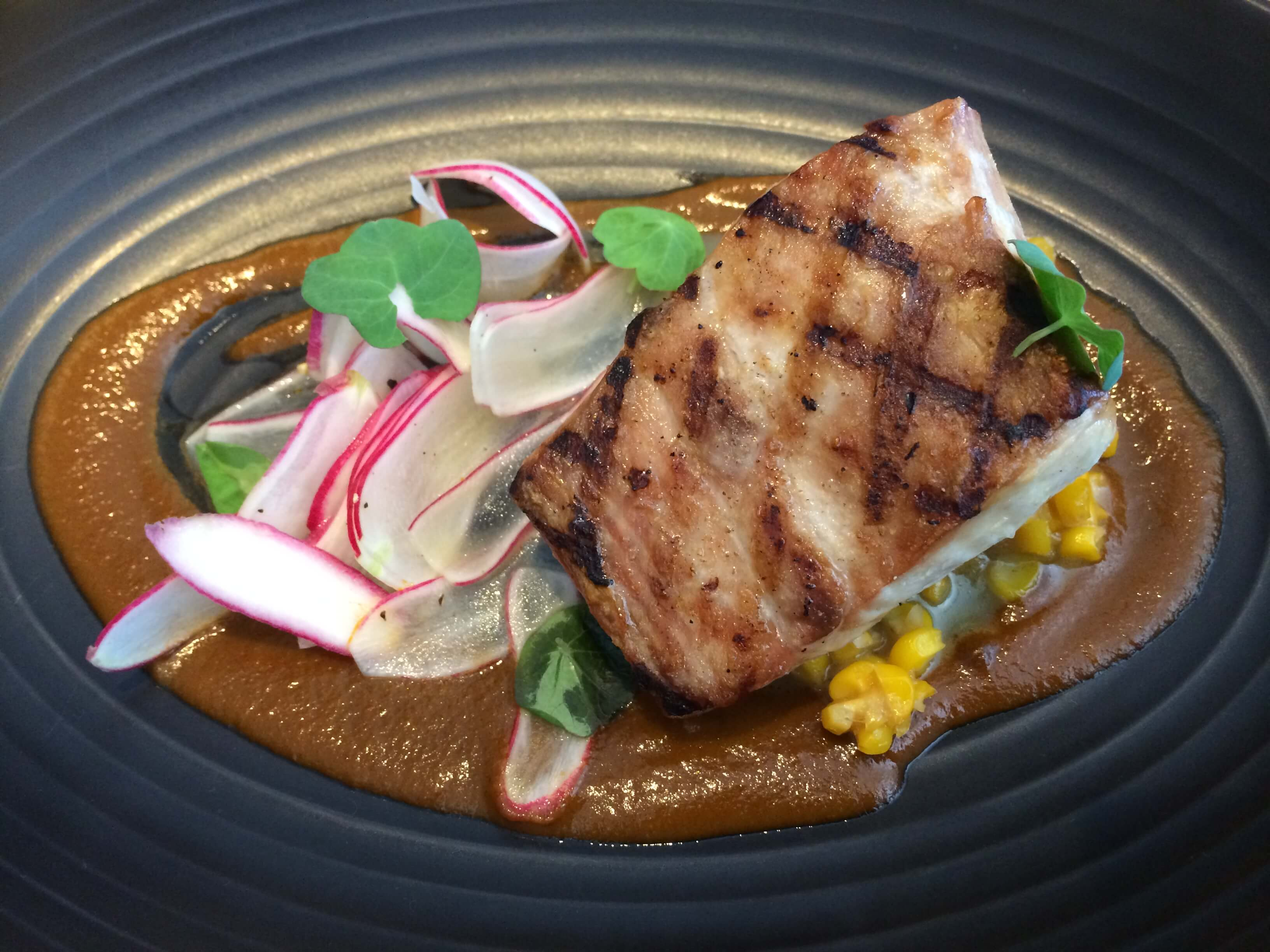 Grilled Local Yellowtail, Ancho Chili-Caramelized Onion Puree, Sweet Corn, Radish