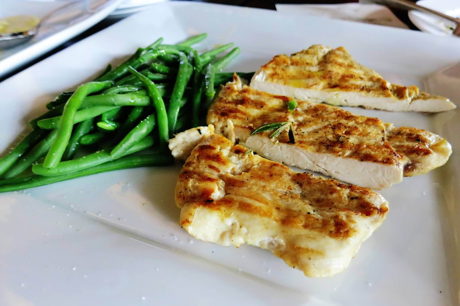 Battuta Florentina (grilled Jidori Chicken breast) and grilled vegetables.