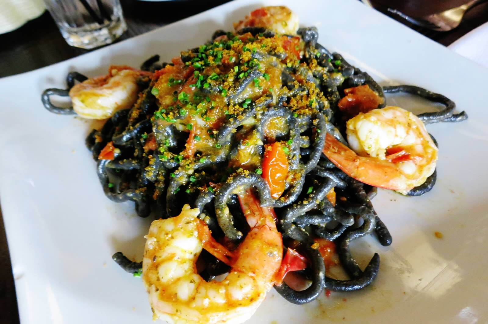 Bigoli Neri alla Bottarga--Black squid ink bigoli, organic cherry tomatoes, shrimp. and bottarga.