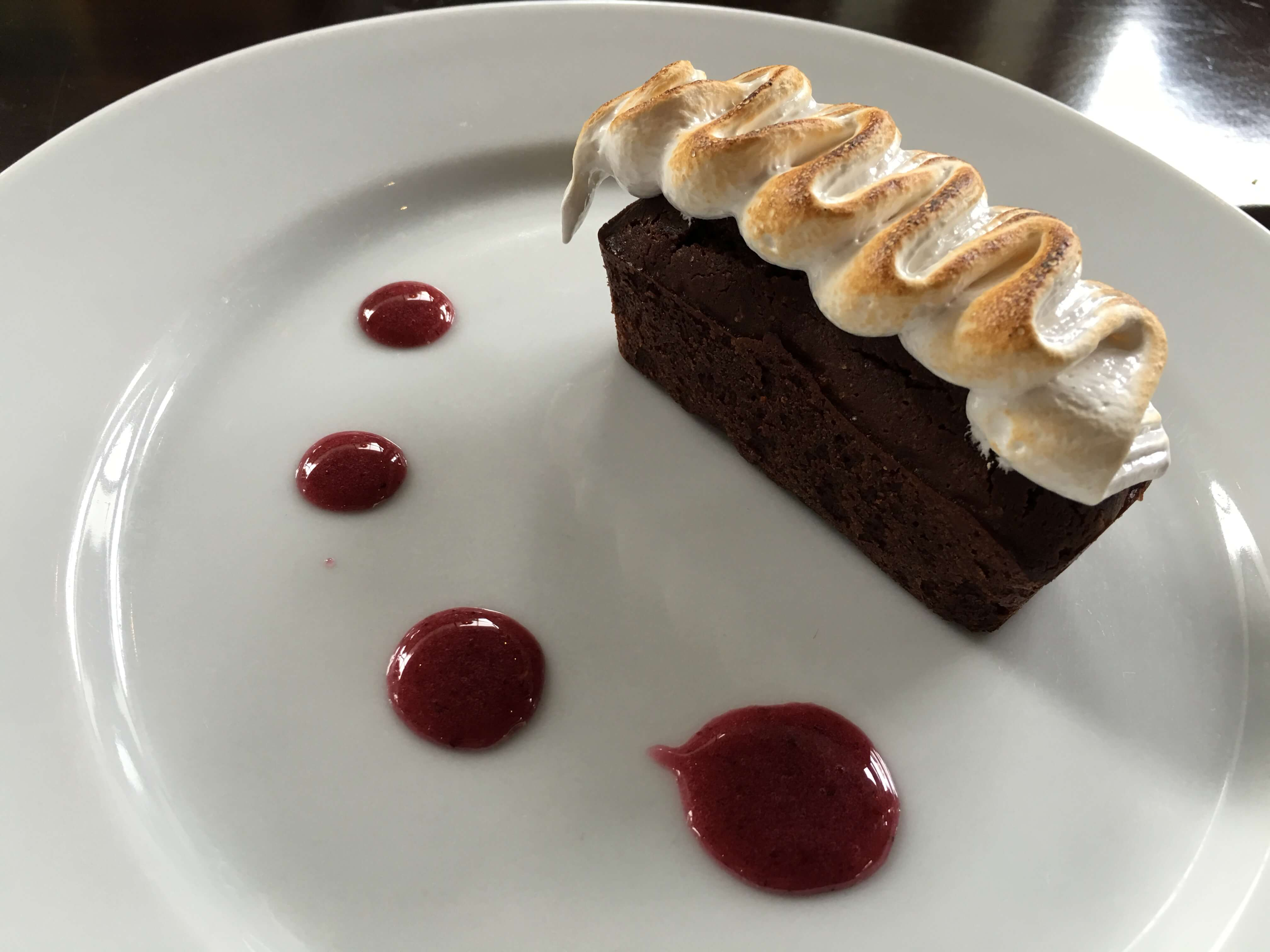 Brownie: marshmallow fluff, berry sauce.