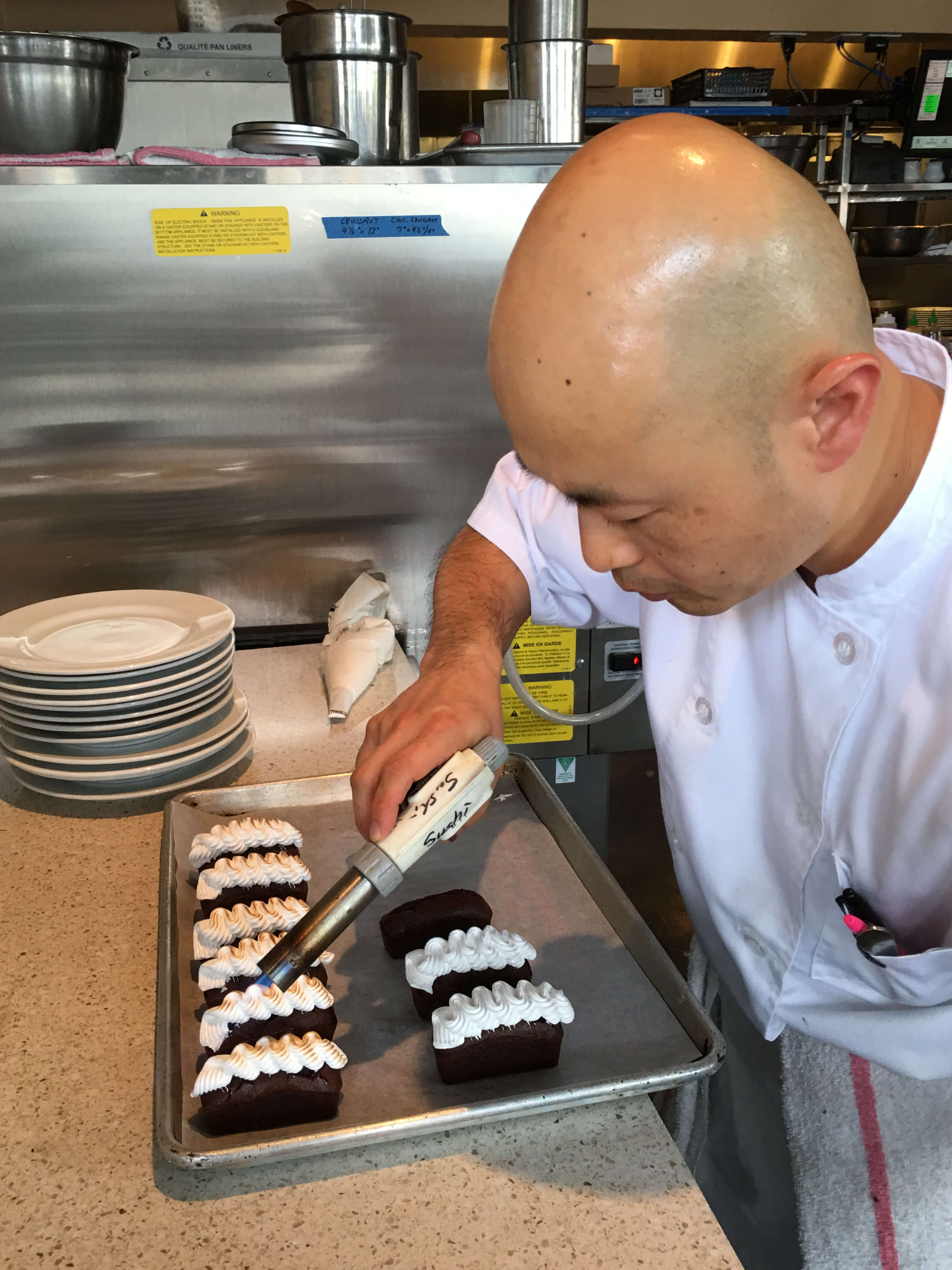 Chef Jason Park puts the finishing touches on dessert.